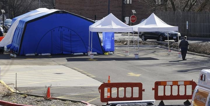 Custom tents and signage for crowd management in hospitals